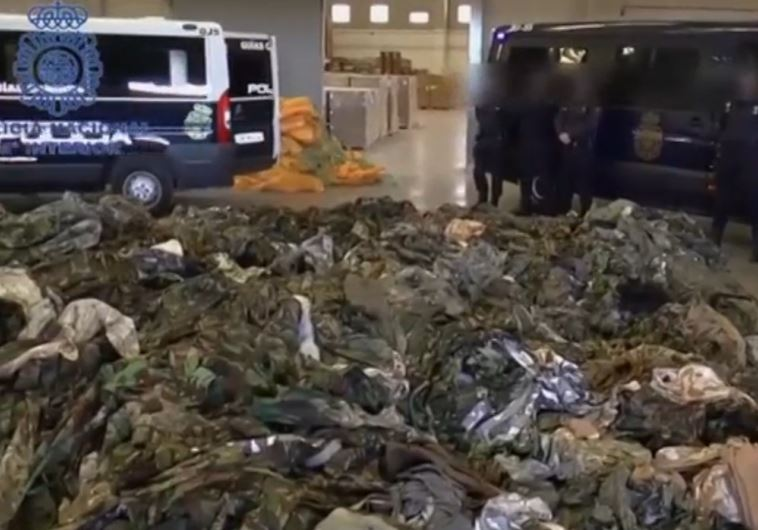 Spanish police seize 20,000 uniforms bound for Islamic State. (photo credit:SCREENSHOT/REUTERS)
