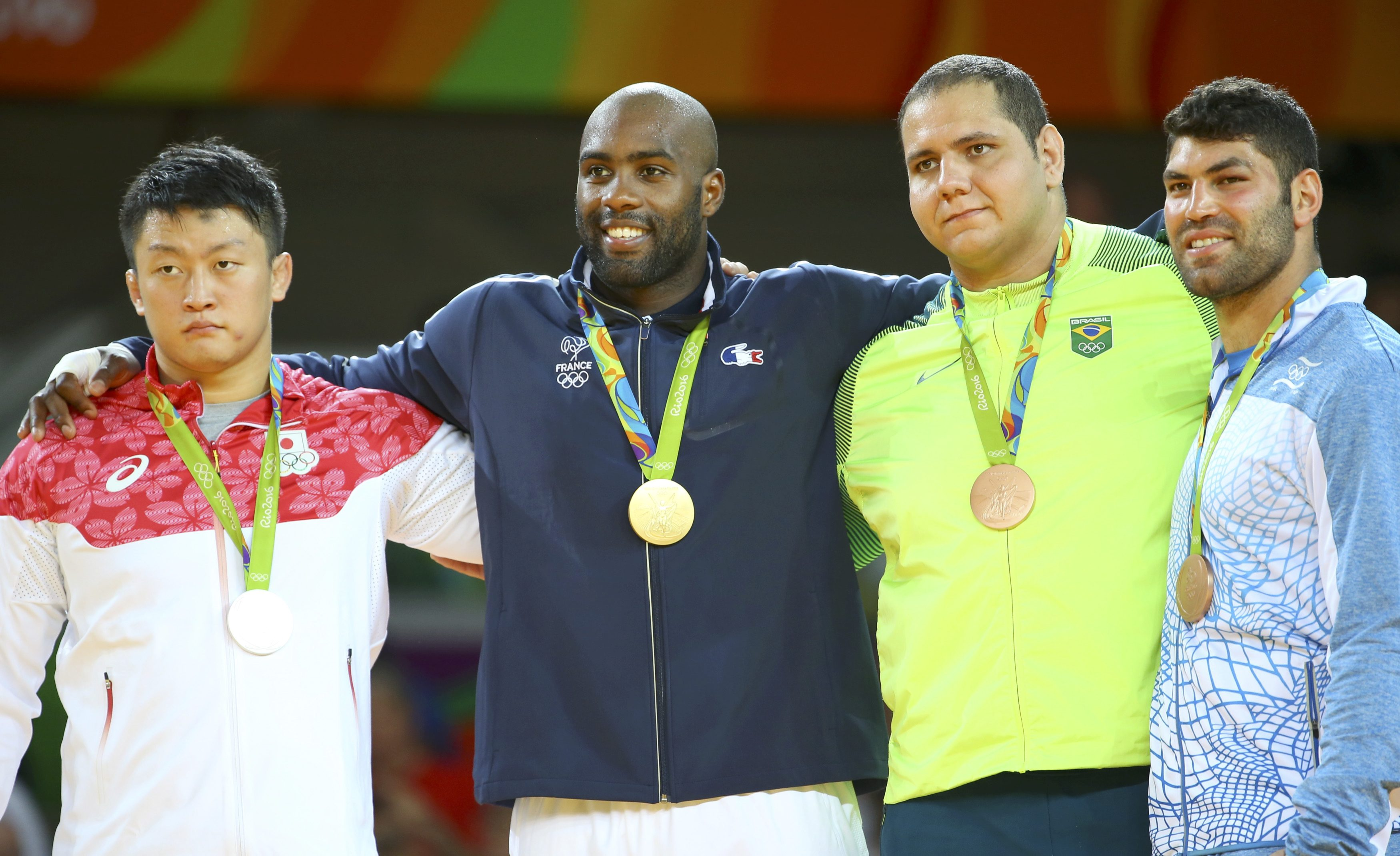 2016 Rio Olympics - Judo - Victory Ceremony - Men +100 kg Victory Ceremony - Carioca Arena 2 - Rio de Janeiro, Brazil - 12/08/2016. (L-R) Hisayoshi Harasawa (JPN) of Japan, Teddy Riner (FRA) of France, Rafael Silva (BRA) of Brazil and Or Sasson (ISR) of Israel attend the ceremony. REUTERS/Murad Sezer FOR EDITORIAL USE ONLY. NOT FOR SALE FOR MARKETING OR ADVERTISING CAMPAIGNS.