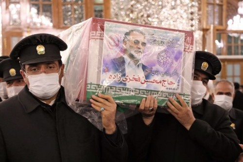 "A handout picture provided by Iran's Defence Ministry on November 29, 2020 shows Servants of the holy shrine of Imam Reza carrying the coffin of Iran's assassinated top nuclear scientist Mohsen Fakhrizadeh during his funeral procession in the northeastern city of Mashhad. - The body of Iran's assassinated top nuclear scientist has been taken to the first of several revered Shiite Muslim shrines ahead of his burial set for November 30, state media reported. The killing of Fakhrizadeh -- whom Israel has dubbed the ""father"" of Iran's nuclear programme -- has once more heightened tensions between the Islamic republic and its foes. (Photo by - / IRANIAN DEFENCE MINISTRY / AFP) / ==  RESTRICTED TO EDITORIAL USE - MANDATORY CREDIT ""AFP PHOTO / HO /IRANIAN DEFENCE MINISTRY"" - NO MARKETING NO ADVERTISING CAMPAIGNS - DISTRIBUTED AS A SERVICE TO CLIENTS =="